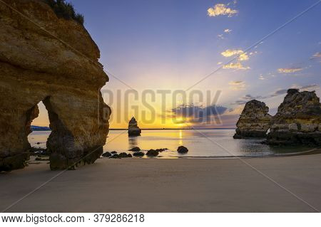 Famous Camilo Beach At Sunrise, Algarve, Portugal
