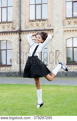 Cute Smiling Confident Schoolgirl Jumping. Sense Of Freedom. Back To School. Cheerful Smart Schoolgi