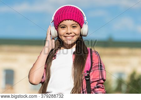 Headphones For Seamless Audio Experience. Happy Kid Listen To Music Playing In Headphones Outdoors.