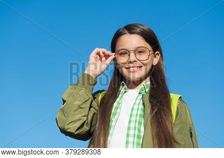 Improved Vision Is Possible. Happy Kid Wear Glasses On Sunny Blue Sky. Defective Vision. Childs Visi