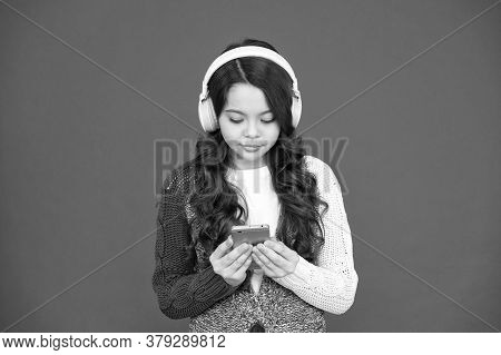 Music Player For Smartphone. Modern Gadgets. Girl Listen Music Modern Headphones And Smartphone. Lis