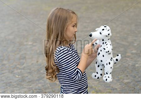 Paying Is State Of Being. Little Child Play With Toy Dog Outdoors. Role Playing. Pretend Play. Child