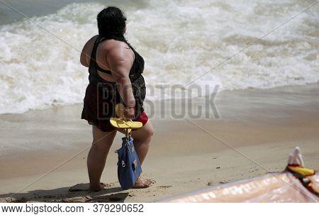 Salvador, Bahia / Brazil - February 17, 2015: Fat Woman Is Seen On Itapua Beach In The City Of Salva