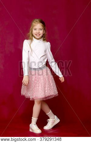 Elegant, Beautiful Girl In A Dress. In Full Growth. The Concept Of Youth Fashion, Happy Childhood.