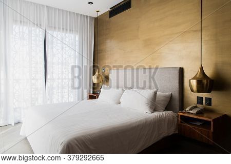 Queen Size Bed With Bed Runner And Reading Lamp In Villa, House And Apartment