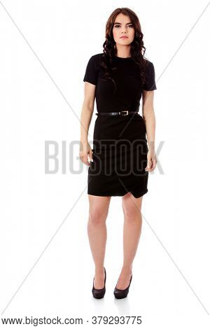 Young woman in bussiness dress standing on white background.
