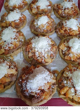 Potato Sopes With Chorizo, Topped With Cream And White Cheese, Traditional Mexican Food