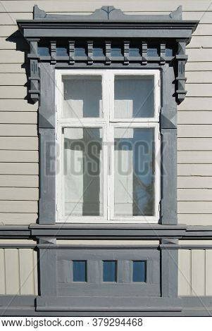 Vintage Wooden Window Decorated With Massive Portico