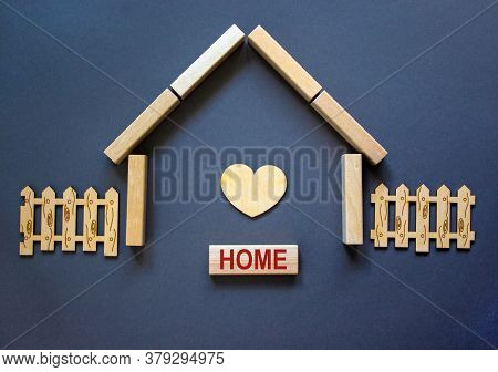 Model Of A Wooden House From Wooden Blocks. Word 'home'. Wooden Heart And Fence. Copy Space. Busines