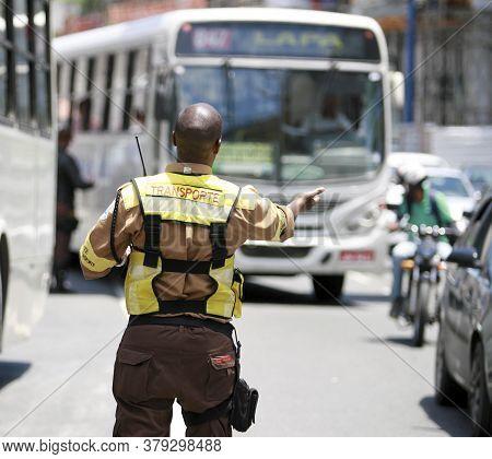 Salvador, Bahia / Brazil - January 6, 2015: Transalvador Transit Agent Seen Guiding Drivers During C