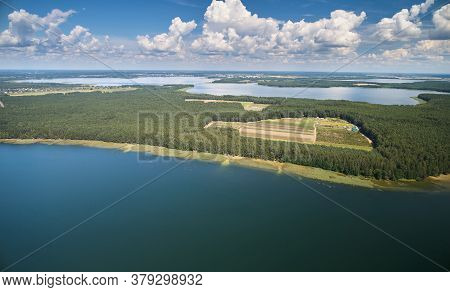 Lake Shore In Forest Background