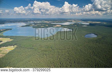 Clean Big Lake In Forest Landscape