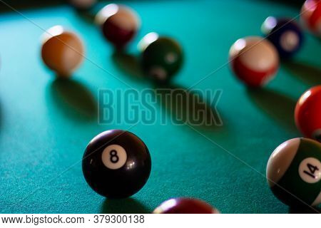 Multicolored Billiard Balls With Numbers On The Pool Table. Sports Game Billiards On A Green Cloth.