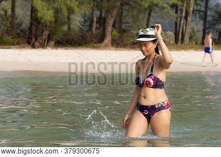 Woman With Hat And Bikini Walk Enjoy At Beach Koh Chang Thailand. Koh Chang Is Located In The Easter