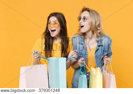 Excited Young Women Girls Friends In Denim Clothes Eyeglasses Posing Isolated On Yellow Background I