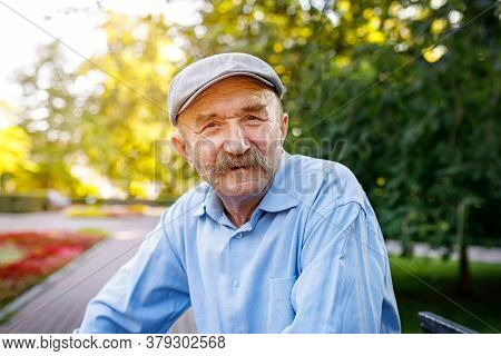 Senior Man In A Park On A Sunny Autumn Day. Close-up Selective Focus