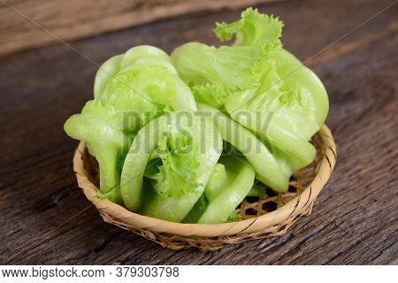 Fresh Frillice Iceberg Lettuce In The Basket On Wooden Background