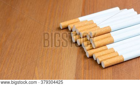 Cigarette, Cigarette On A Wooden Background With Copy Space,concepts About The Dangers Of Smoking