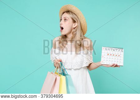 Amazed Young Woman In White Dress Hat Hold Periods Calendar For Checking Menstruation Days Package B
