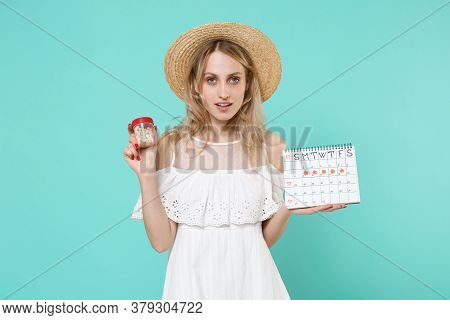 Young Woman In Hat Hold Periods Calendar For Checking Menstruation Days Medication Tablets, Aspirin