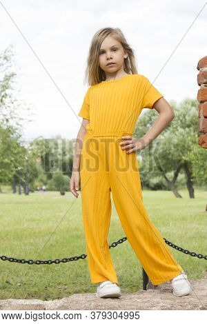A Beautiful Little Girl Six Seven Years Old With Long Blond Hair And Gray Eyes In A Yellow Dress Sui
