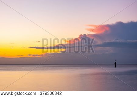 Nothing But Skies And Silky Smooth Water At Glowing Ocean Sunset With Copy Space
