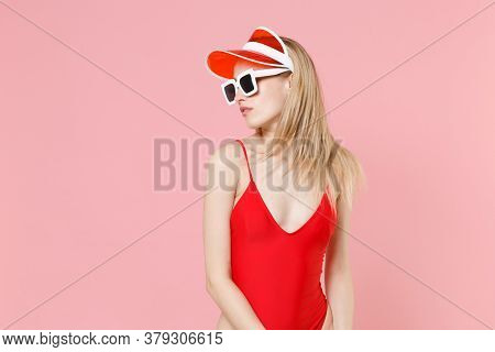 Beautiful Young Blonde Woman Girl In Red One-piece Swimsuit Cap Eyeglasses Isolated On Pastel Pink B