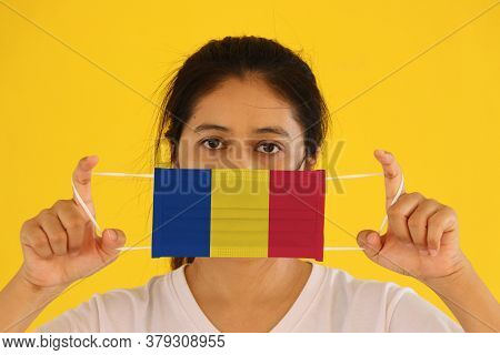 A Woman In White Shirt With Romania Flag On Hygienic Mask In Her Hand And Lifted Up The Front Face O