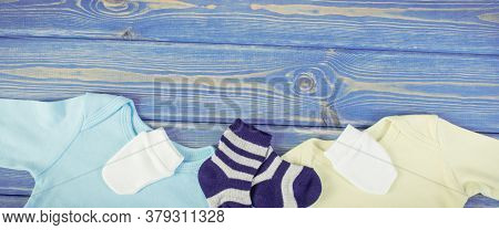 Clothes For Little Baby Boy, Extending Family Concept, Copy Space For Text Or Inscription On Blue Bo