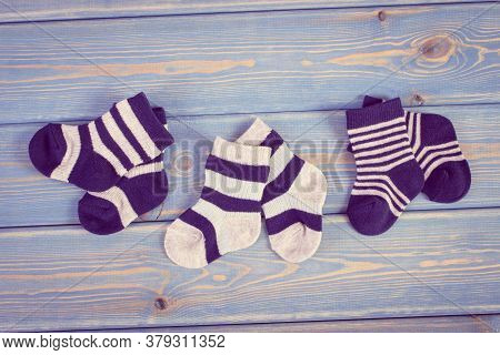 Vintage Photo. Socks For Little Baby Boy, Extending Family And Expecting For Kids Concept