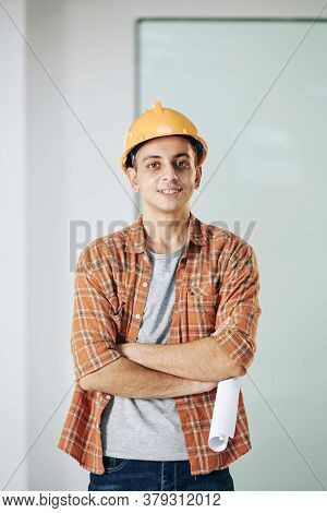 Portrait Of Handsome Young Middle Eastern Construction Worker In Hardnat And Plaid Shirt