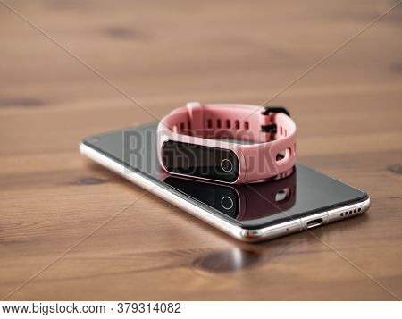 Fitness Tracker On Smartphone Wooden Tabletop. Pink Female Pedometer Or Wearable Device On Smartphon