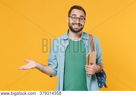 Smirked Smiling Young Man Student In Casual Clothes Glasses Backpack Hold Books Isolated On Yellow B