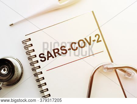 Top View Of Sars-cov-2 Lettering Surrounded By Medical Stuff With Sars Cov 2 Fight Concept