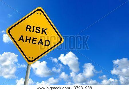 Risk Ahead Traffic Sign On Bluesky