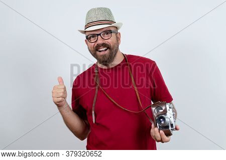 Man Portrait On White Background. Cheerful Man Portrait. Man Portrait With Vintage Camera. Man Smili