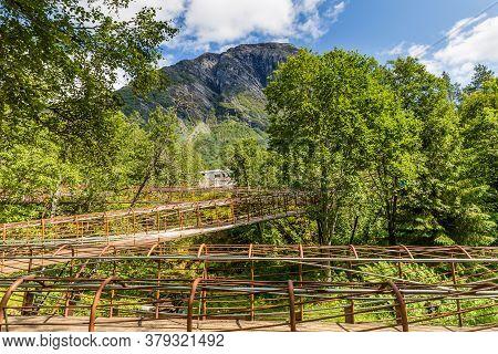Narrow And High Ravine Gudbrandsjuvet Along National Scenic Route Geiranger Trollstigen Road 63 In M