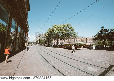 Strasbourg, France - May 30, 2020: Few Pedestrians And Locals In French City Center Near Stores And