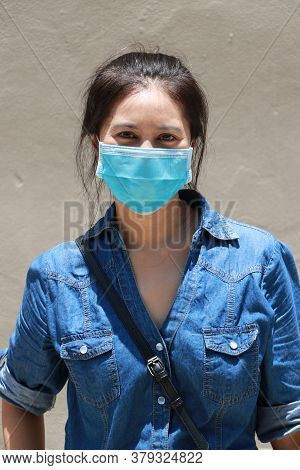 Masked Asian Woman Prevent Germs And Wear Denim Skirt Dress. Tiny Particle Or Virus Corona Or Covid