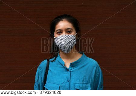 Masked Asian Woman Prevent Germs And Wear Blue Shirt. Tiny Particle Or Virus Corona Or Covid 19 Prot