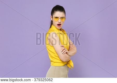 Side View Irritated Shocked Young Brunette Woman Girl In Yellow Casual Shirt Posing Isolated On Viol