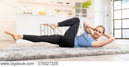 Panoramic White caucasian fit sporty woman doing yoga side plank in living room at home for mental health and meditation. Working out, fitness sport and healthy lifestyle concept.