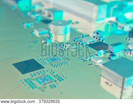 Fragment Of A Pc Motherboard. Part Of The Main Circuit Board Close-up. Bright Aquamarine Inverted Ba