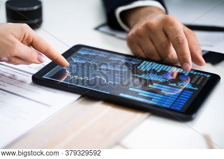 Financial Analyst And Business Advisor Accounting Review On Tablet