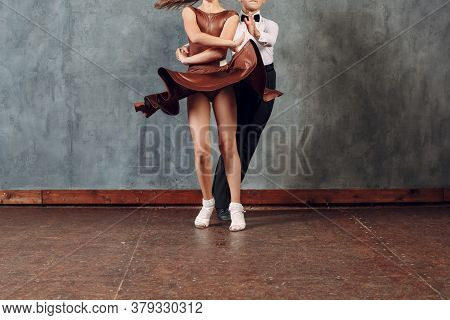 Young Dancers Boy And Girl Dancing In Ballroom Dance Samba. Close Up Legs.