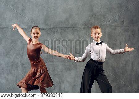 Young Couple Boy And Girl Dancing In Ballroom Dance Samba