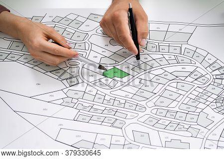 Cadastre Land Map. Cartographer Locating Building Plot