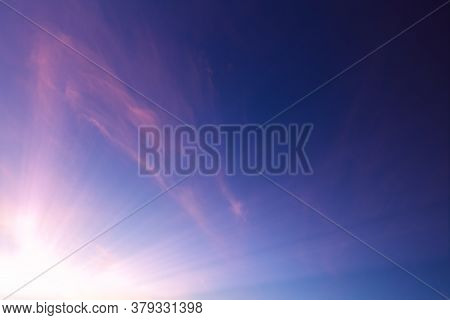 Pink Wispy Clouds In A Blue Sky Sunset