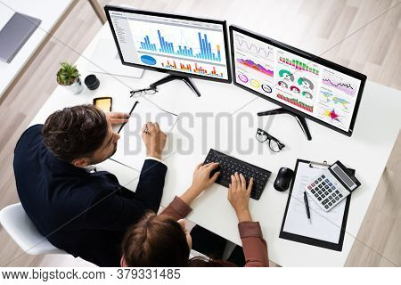 Financial Advisor And Business Analyst Working On Computer