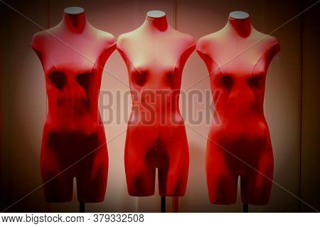 Mannequins On A Showcase In Red Clothes On A Red Background